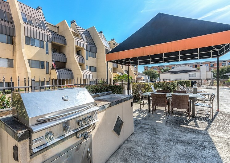 Outdoor Grill With Intimate Seating Area at Augusta Court Apartments, Houston, 77057