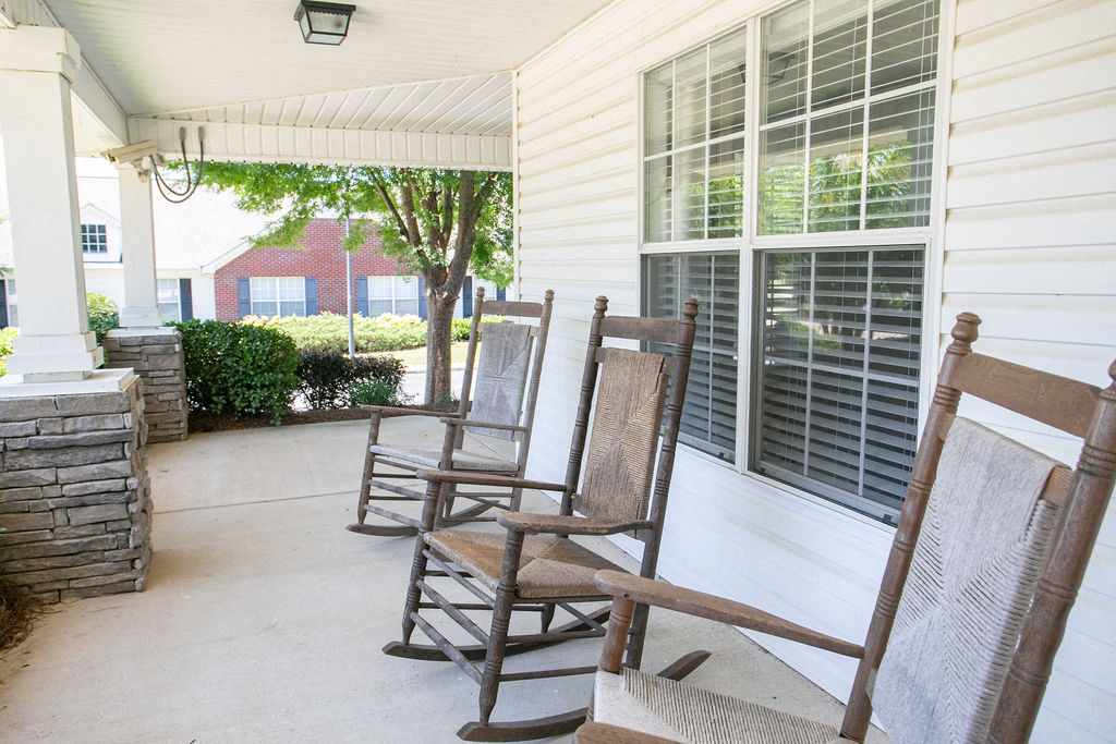 rocking chairs on front porch of clubhouse