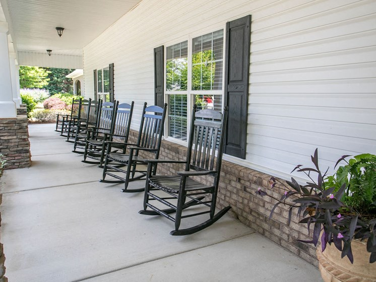 front porch of clubhouse with rocking chairs