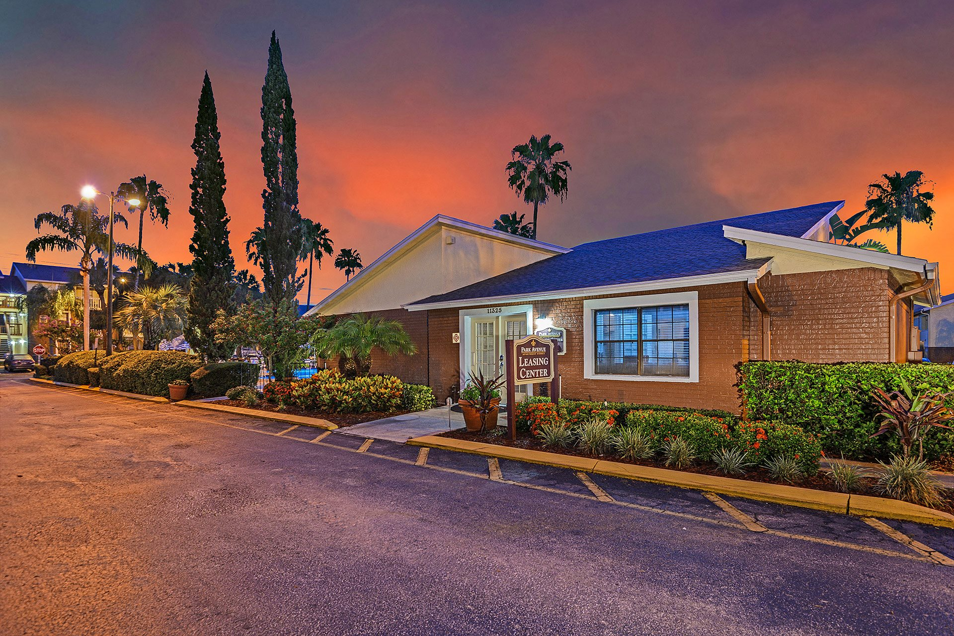 Park Avenue Apartments Tampa Florida Clubhouse with Glowing Orange Sunset in Background