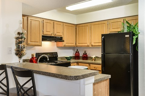 Timber Chase at Sarasota Bay Sarasota Florida Model Kitchen Bar with Stools and View of Kitchen