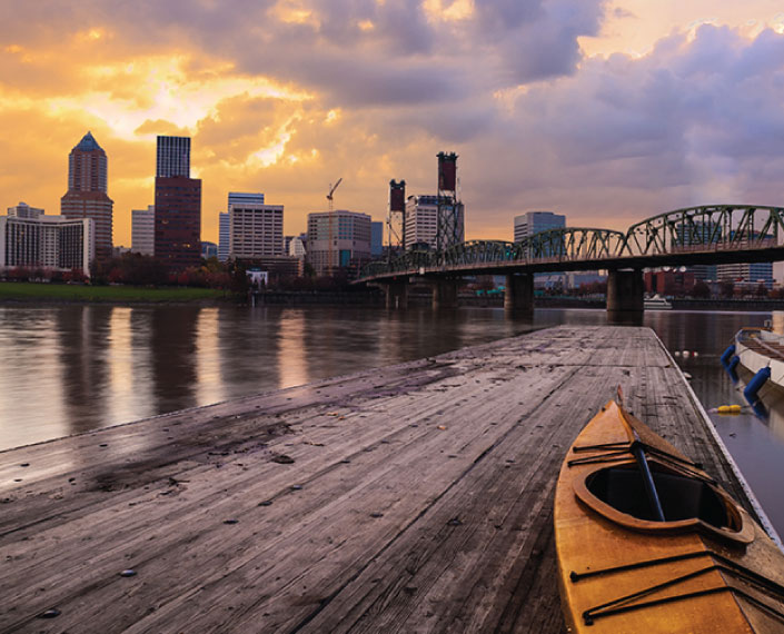 The Hawthorne Bridge in downtown Portland, Oregon, as seen from a kayak dock along the Eastbank Esplanade