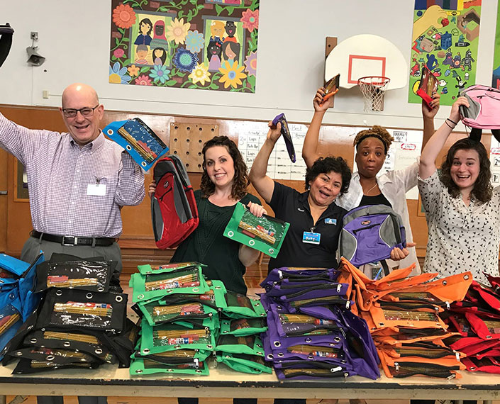 The TMT Development team volunteers with Schoolhouse Supplies to help every kid get the school supplies they need.