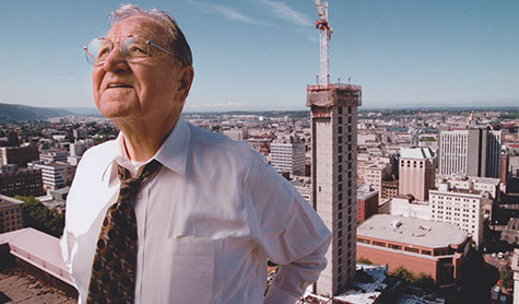 TMT Development founder Thomas Moyer with Fox Tower construction in the background.