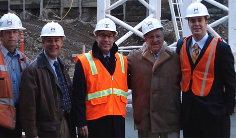 TMT founder Thomas Moyer and development team at Park Avenue West construction site.