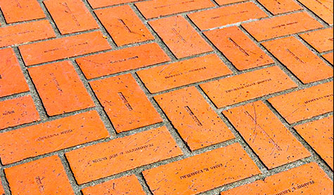 Signature bricks shape a sea of red at Pioneer Courthouse Square in Portland, Oregon.