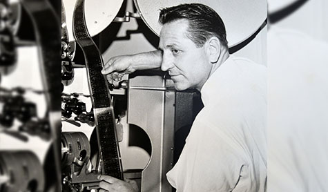 TMT Development founder Thomas Moyer runs a vintage film projector in Portland, Oregon.