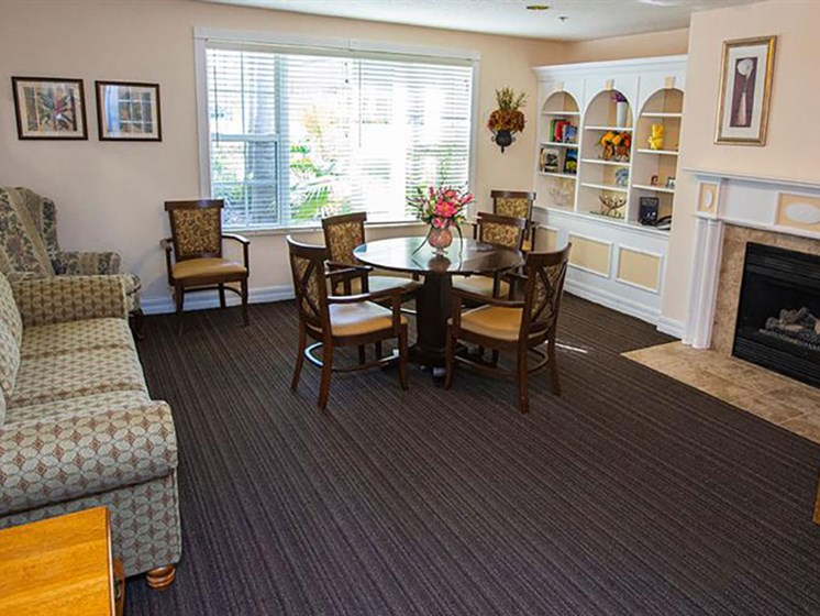 Clubhouse With Fireplace at Savannah Court & Cottage of Oviedo, Oviedo, FL