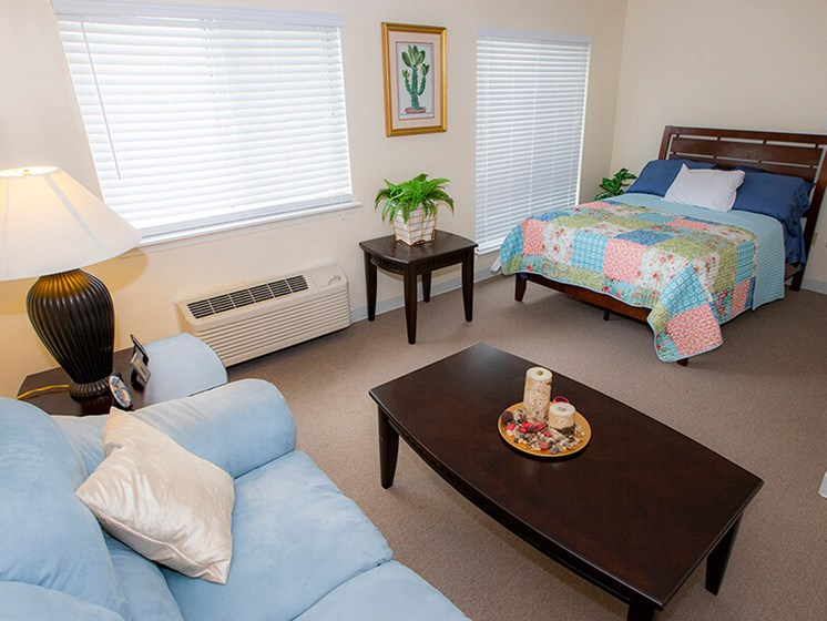 Bedroom With Sofa at Savannah Court of The Palm Beaches, Florida
