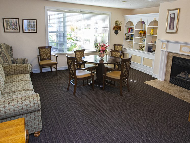 Lounge Area With Fireplace at Savannah Court & Cottage of Oviedo, Oviedo, FL