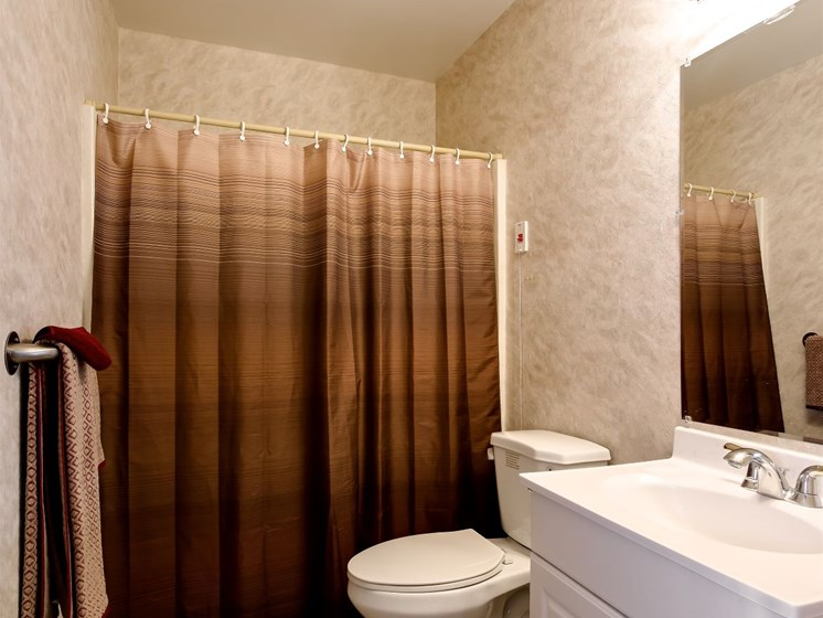 Full-size bathrooms with walk-in showers.