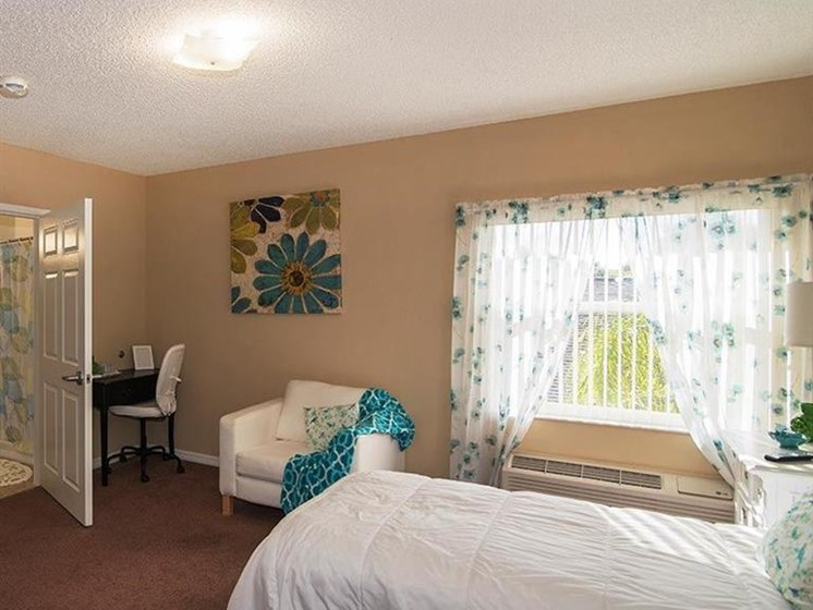 Bedroom With Window at Sun City Senior Living, Ruskin