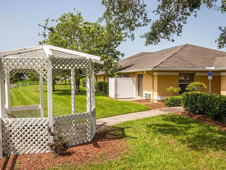 Patio, Lush Garden at Sun City Senior Living, Florida