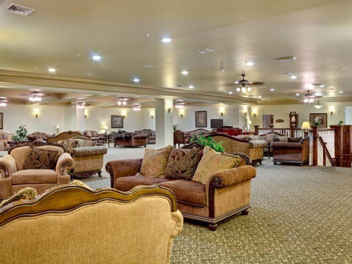 Participate in great entertainment in our communal living room at Pacifica Senior Living San Martin in Las Vegas, NV