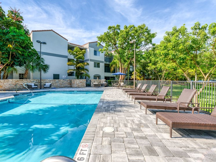 Relax by our fully heated pool in Sunrise, FL.