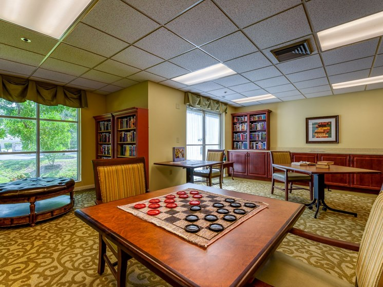 Play a game in our game room at Pacifica Sunrise.