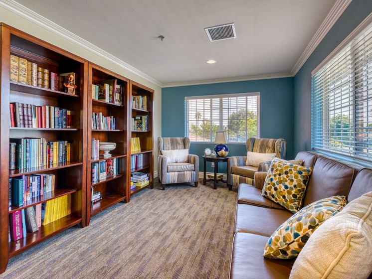 Enjoy a good book in our library at Pacifica Senior Living South Coast.