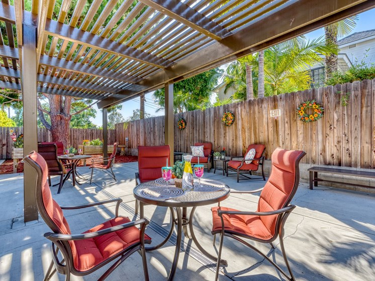 Relax on our trellis patio at Pacifica Senior Living South Coast