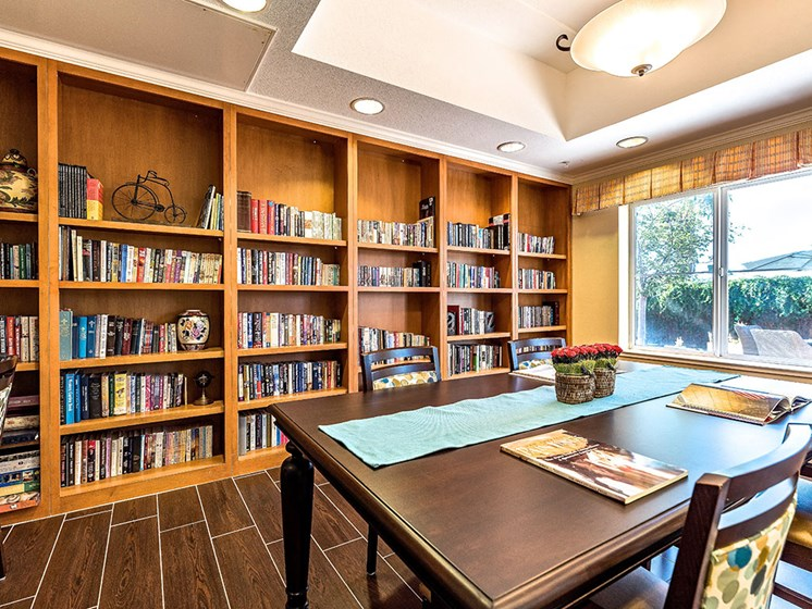 Whole Wall Book Shelf In Library at Pacifica Senior Living Union City, Union City, CA, 94587