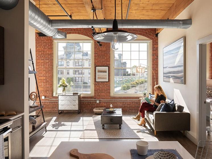Living Room With Oversized Windows at Thorndike Exchange, Lowell, Massachusetts