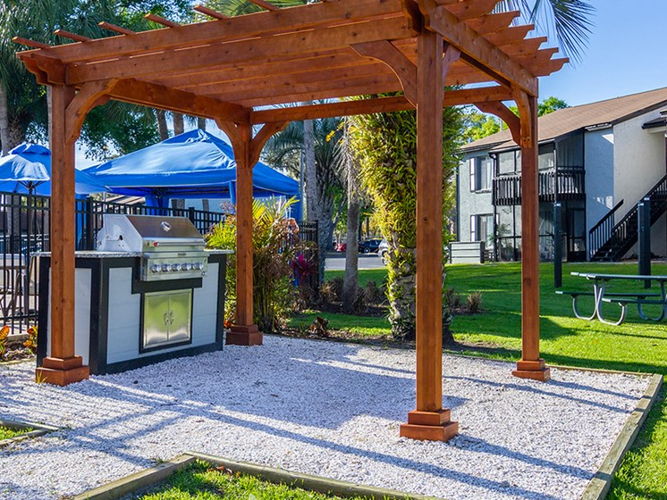 outdoor grill under wood pavilion at Jacksonville FL apartment complex