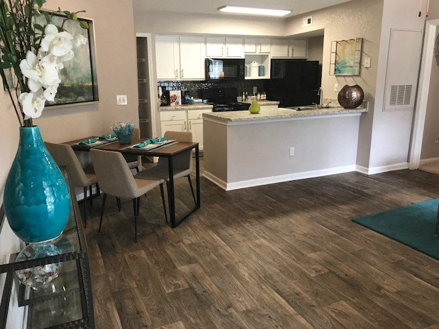 Tallahassee apartment with open concept living area featuring wood-look flooring
