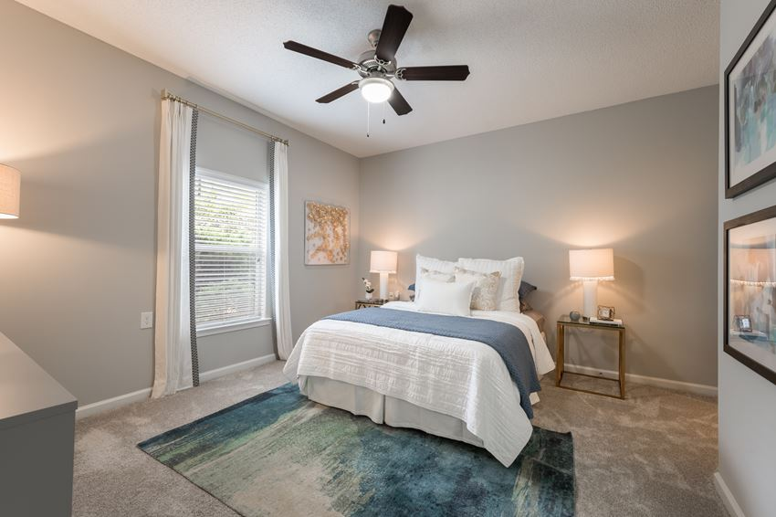 Furnished bedroom with ceiling fan at Chace Lake Villas apartments for rent in Birmingham, AL