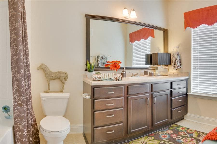 Bathroom vanity with large mirror in an apartment in Macon GA