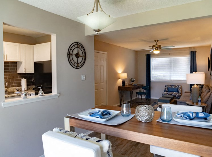 Dining area with table and chairs in Forest Ridge apartments
