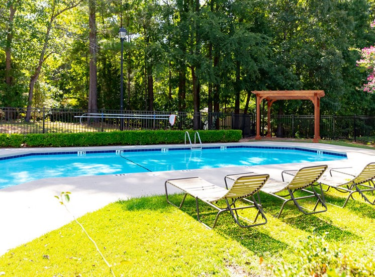 Swimming pool and deck at Forest Ridge Apartments
