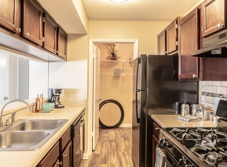 Kitchen with black appliances in Macon apartment