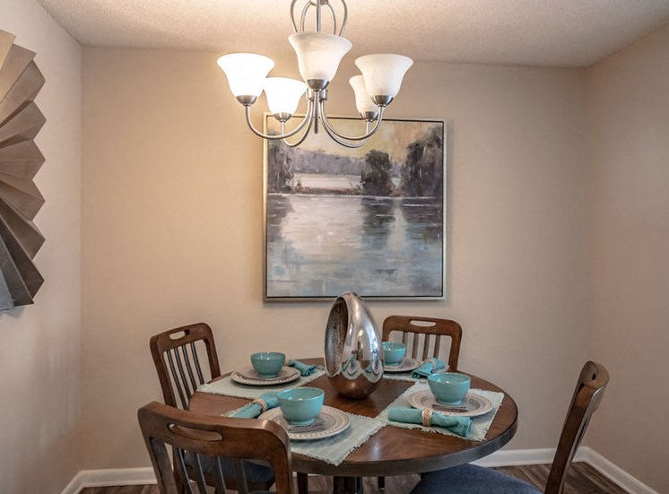 Dining area in Forest Pointe Macon apartment with table and chairs