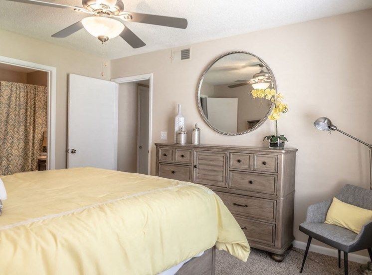 Forest Pointe apartment bedroom with bed and dresser