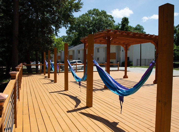 poolside sundeck with hammocks at apartment complex in Macon GA