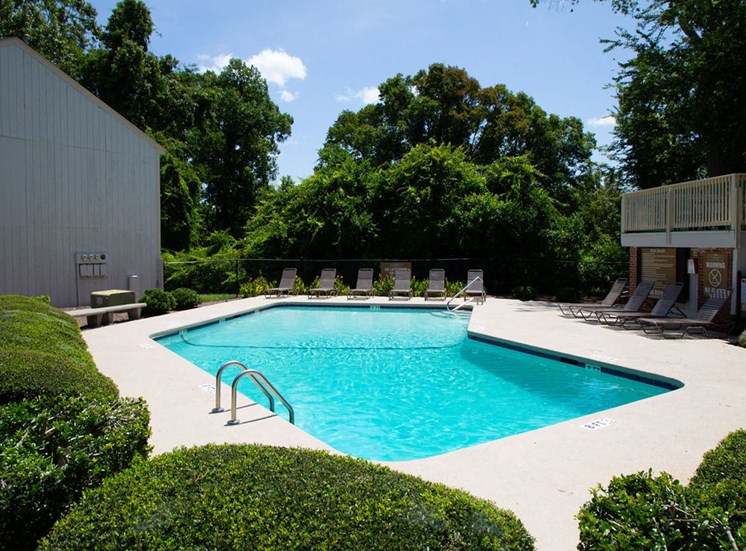 pool at apartments in Macon GA with poolside lounge chairs
