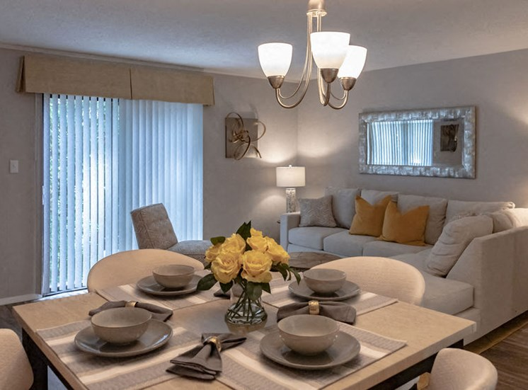 dining table set with plates and view of the living room in a Macon GA apartment