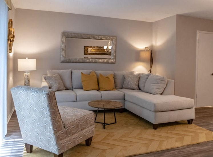 apartment living room with gray furniture and yellow carpet