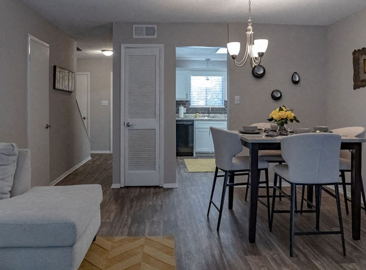 apartment dining area with wood-style flooring at Magnolia Crossing