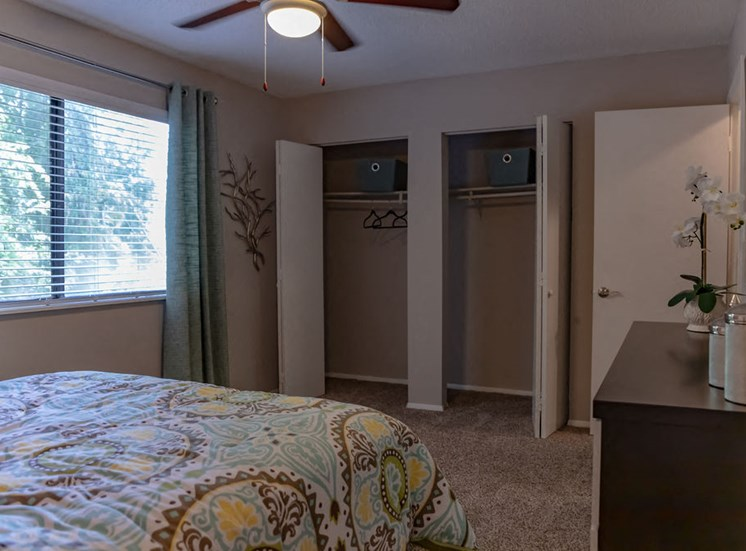 Macon apartment bedroom with ceiling fan and two closets with open doors