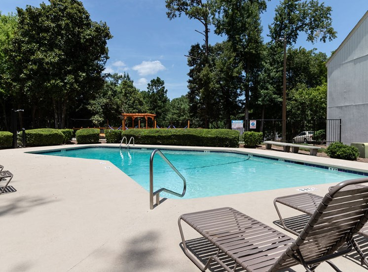 Macon GA apartments swimming pool and poolside lounge chairs