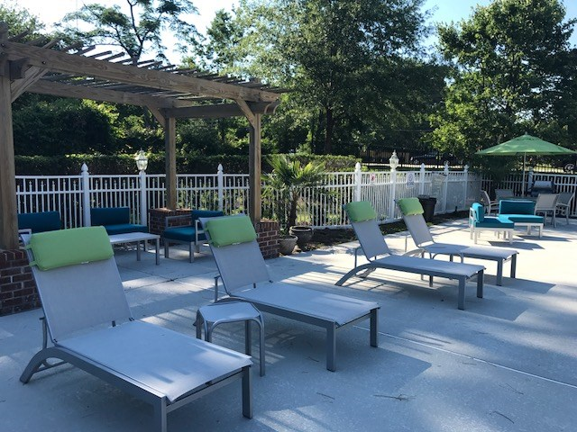 Sundeck with lounge chairs at the Crescent Commons Swimming Pool