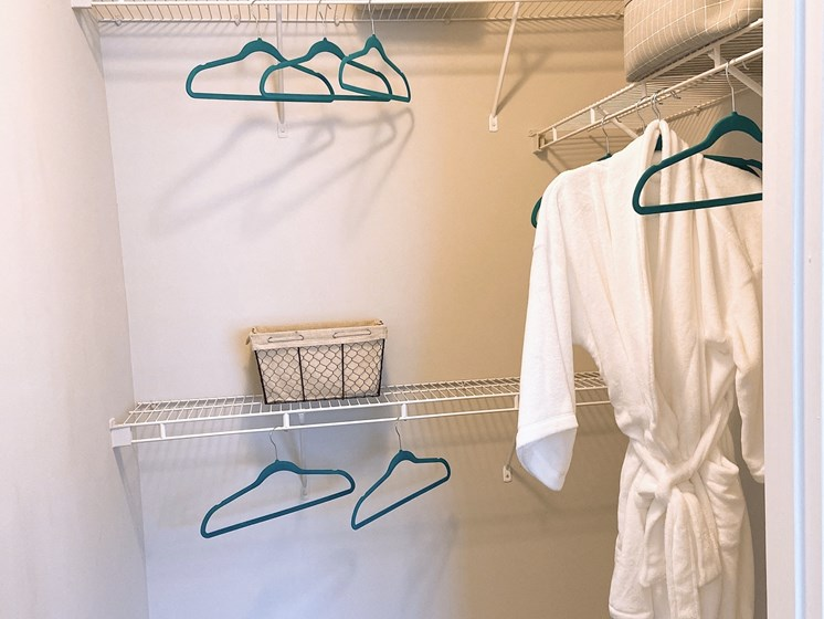 walk-in closet with shelves and bathrobe in an apartment in Fayetteville