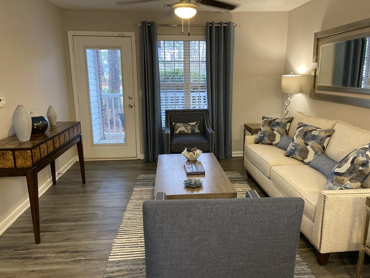 furnished apartment living room with wood-look flooring at Crescent Commons