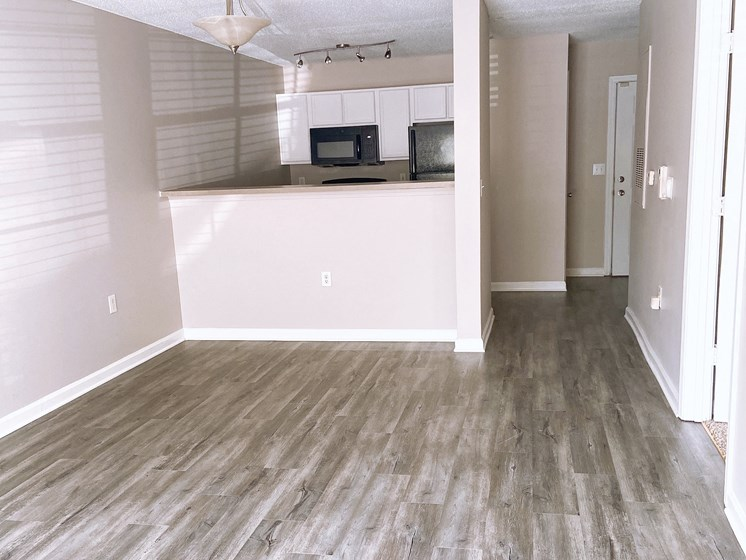 empty Fayetteville apartment living room and kitchen with wood-look flooring