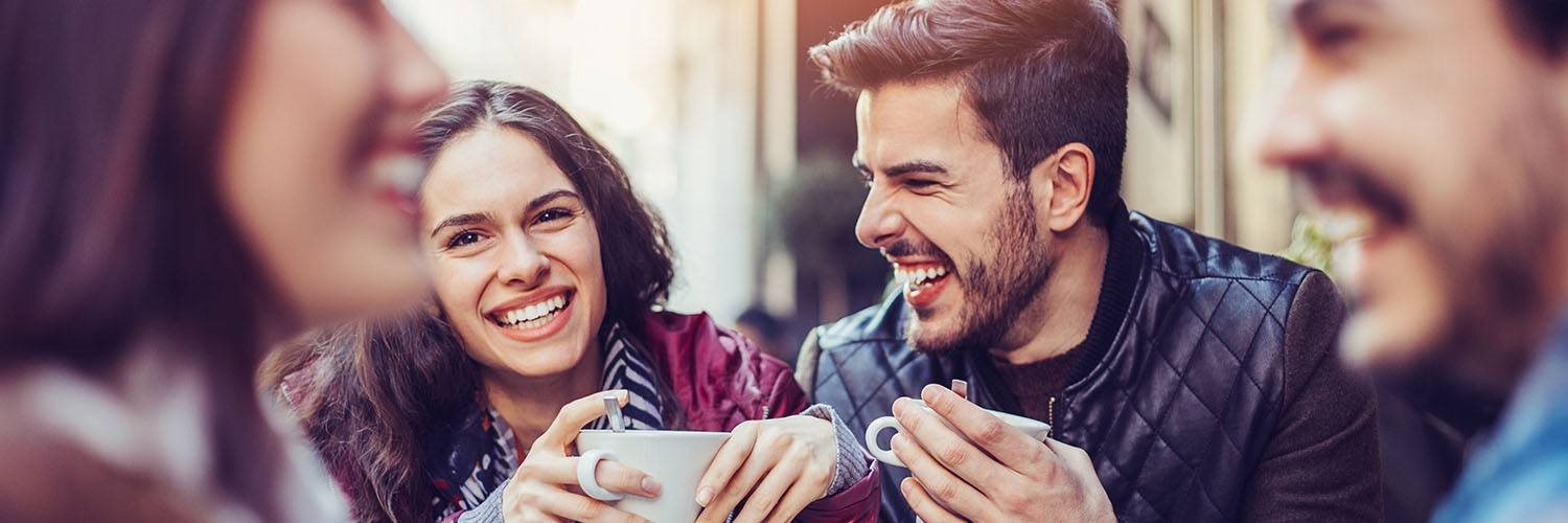 young adult coffee laughing with friends