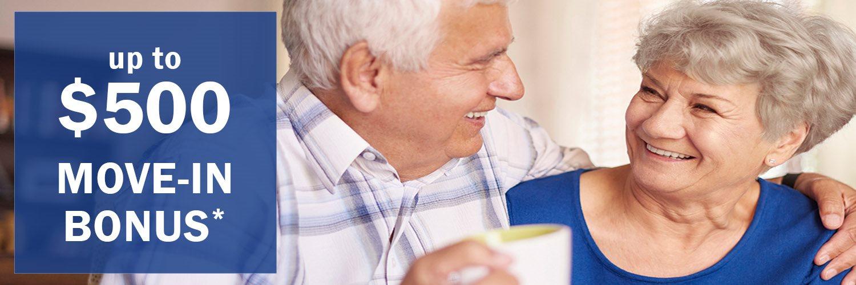 Happy smiling senior couple featuring a $500 Move-in Bonus