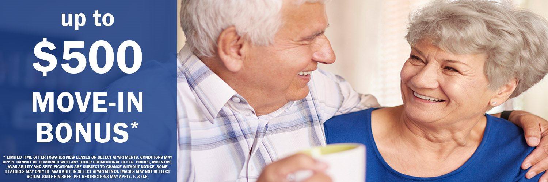 Happy senior couple featuring $500 move-in bonus