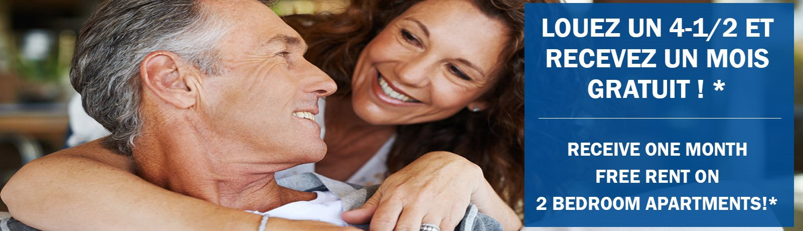 Woman hugging man from behind while both smile featuring one month free rent on 2-bedrooms