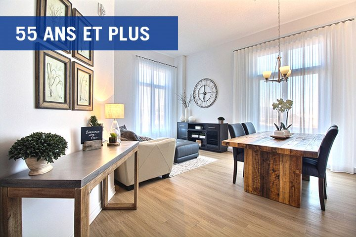 La Voile Boisbriand living area featuring large floor to ceiling windows in Boisbriand, QC