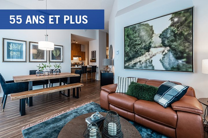 Living and dining room with luxury flooring and modern finishes at La Voile Pointe-Claire apartments in Point-Claire, Quebec